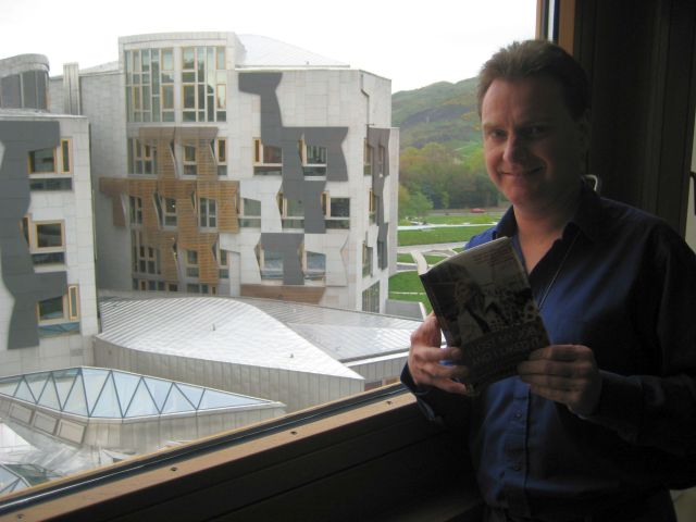 "Myself in the MSP block of the Scottish Parliament with a copy of the book I helped Lilou Mace write: ""I Lost My Job and I Liked It"". (Photo courtesy of Stefan Buettner)"