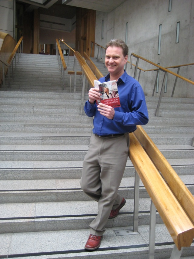 "Myself in the Scottish Parliament with a copy of the book I helped Lilou Mace write: ""I Lost My Job and I Liked It"". (Photo courtesy of Stefan Buettner)"