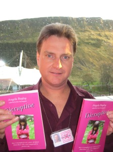 Eric shows freshly printed copies of 'Disruptive'.