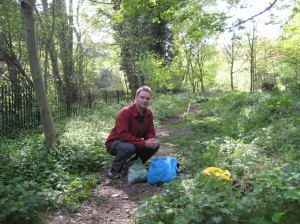 Eric Swanepoel next to the Water of Leith, Stockbridge, with the wild foodplants he gathered there. 17 April 2011.