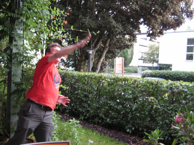 Throwing a slug over the hedge onto the grass verge outside.