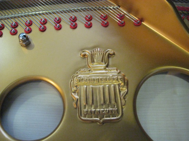The Steingraeber logo on a grand piano.