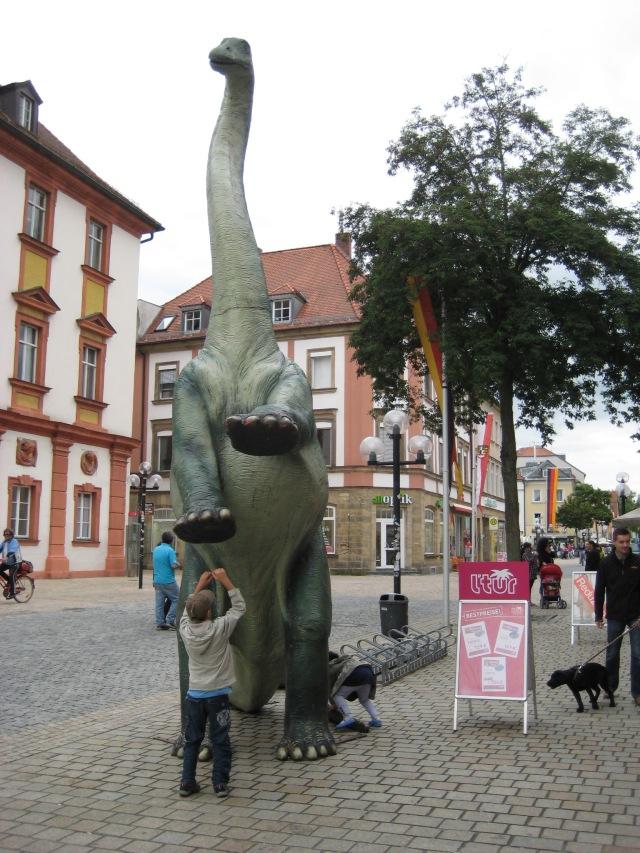 Boy teasing dinosaur in Bayreuth