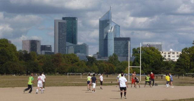 Football with La Defense on the skyline.